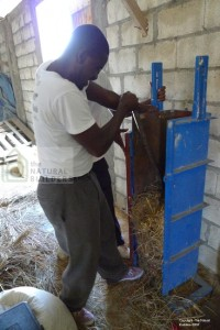 Creation of the first Haitian straw bale (2010) the bale press is an improved model of one used extensively in Pakistan for home construction.